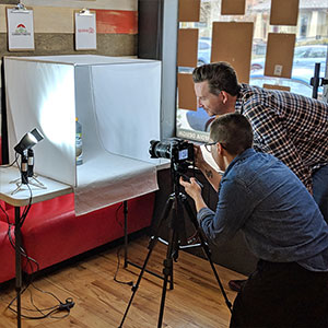 One Ton Team doing a product photoshoot at the office