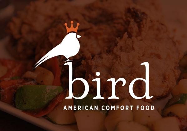 Bird Denver logo over a darkened photo of food