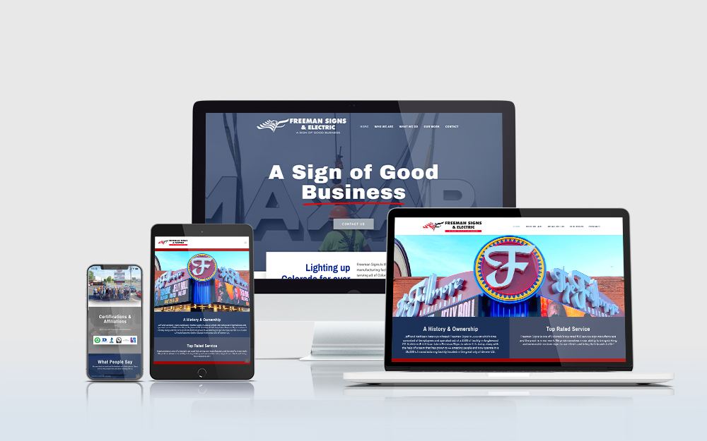 Freeman Signs website displayed on multiple devices