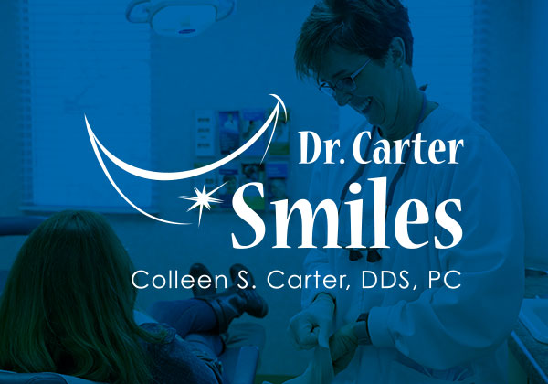 Dr. Carter Smiles logo in white over a blue photo of a dentist and her patient
