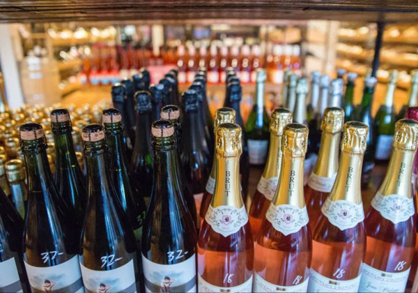 rows of champagne bottles in a store