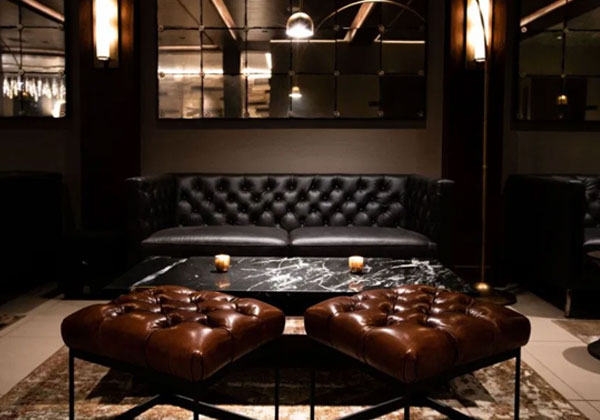 leather couch and stools at a lounge